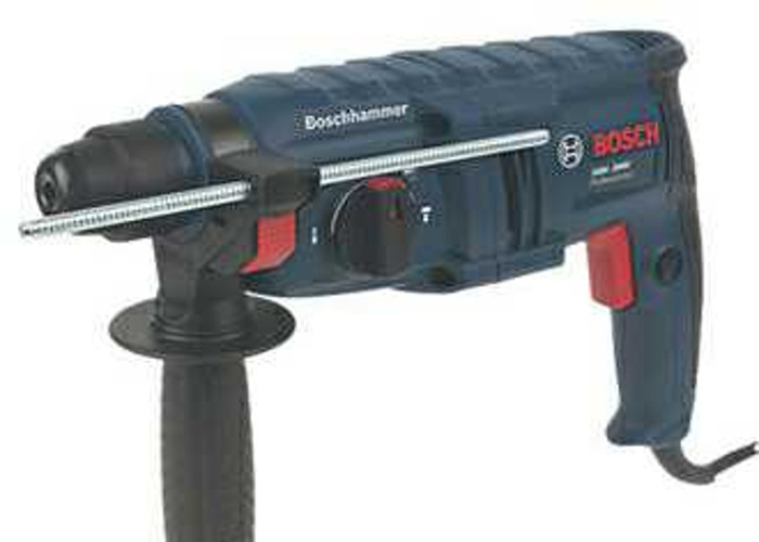 bosch hammer sds drill with some attachments. - 1