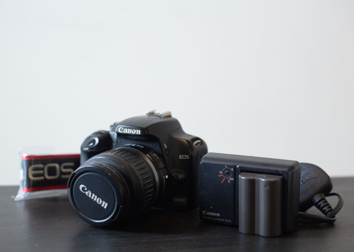 Canon 1000d with battery charger and camera strap - 1