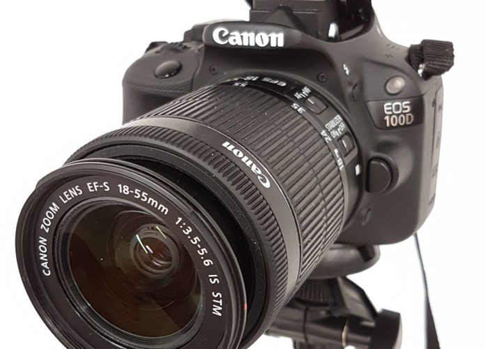 canon 100d-camera-with-tripod-93638912.jpg