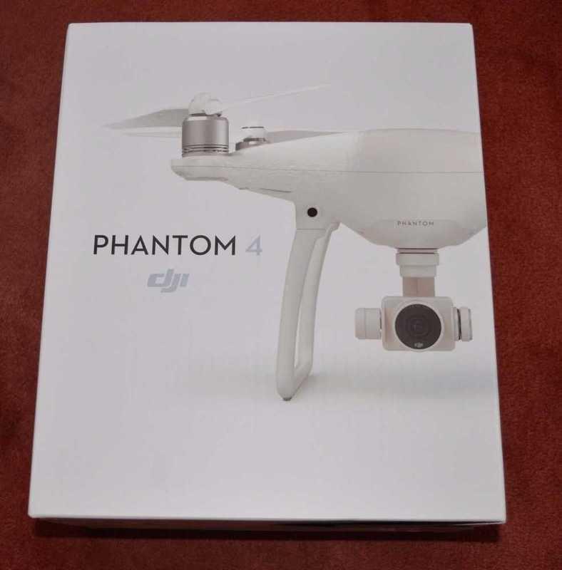 dji phantom-4--4k-drone--controller-case-2-batteries-42362146.jpg