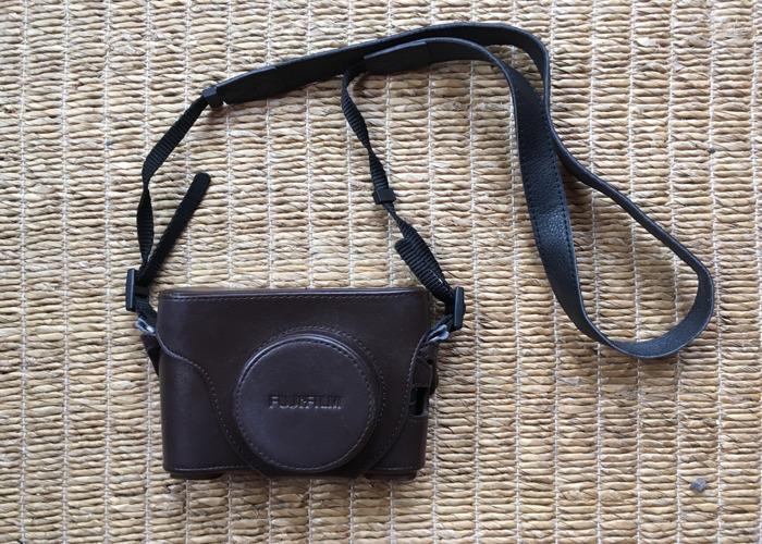 fuji x100s-camera-with-custom-leather-case-32978877.jpeg