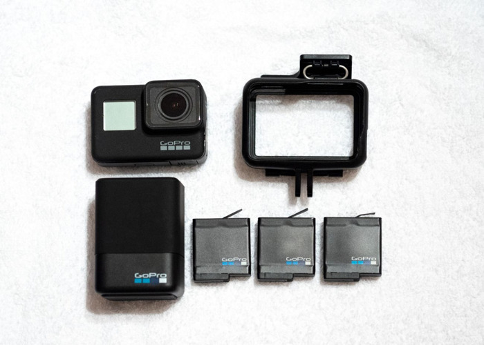 GoPro Hero 7 Black + 3 Batteries, Charger, 64GB Card & Case - 1