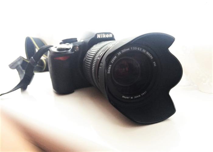 Cámara réflex digital Nikon D3100 con lente - 1