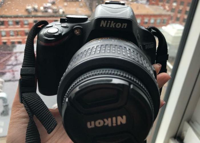 Nikon D5100 +  Zoom lens  - 1