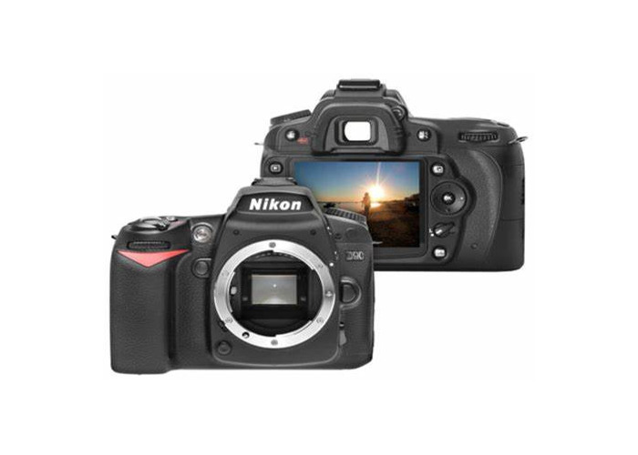 Nikon D90 with 2 batteries, set of memory cards and lens - 1