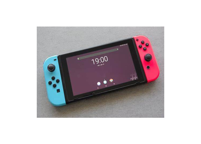 Nintendo Switch & extra Controllers - 1