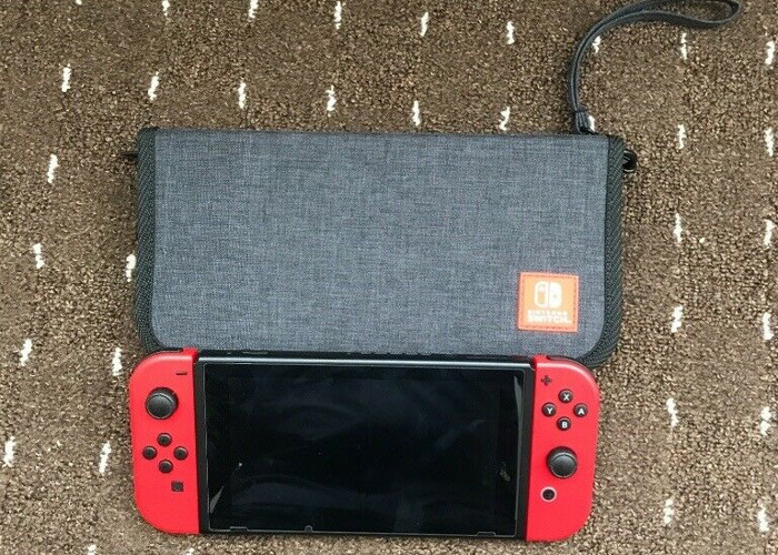 Nintendo Switch With Case - 1