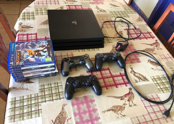 PS4 pro 1TB with Contoller and 8 games - 1