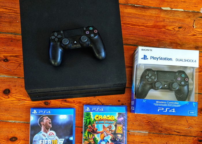 Rent PS4 Pro with Two Controller + FIFA 19 + FIFA 18 + Crash Bandicoot in  London
