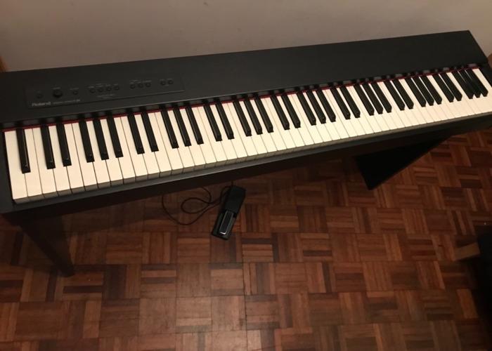 roland f20-digital-keyboard-piano-88-weighted-keys-17983380.jpeg